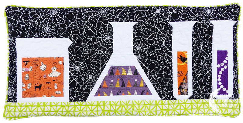 Potions Halloween pillow by Sylvia Schaefer | Flying Parrot Quilts | www.flyingparrotquilts.com